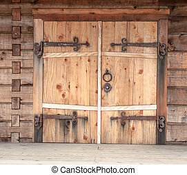 beautiful rustic door with iron hinges on historic building