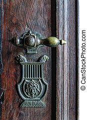 Vintage doorknob on antique door