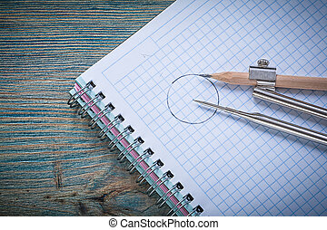Vintage drawing compass pencil checked copybook on wood board co