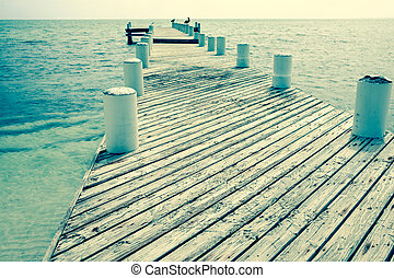 Vintage effect image old jetty.