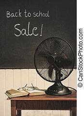Vintage electric fan on table