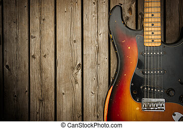 Vintage Electric Guitar Background - A beat up, dirty and...