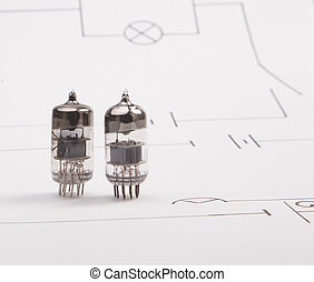 Vintage electron tube on a background of the electric scheme