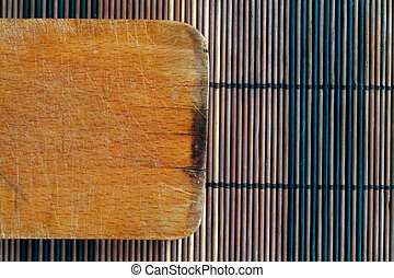 Vintage empty cutting board on bamboo planks, food background concept