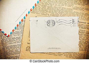 Vintage envelope on aged newspaper