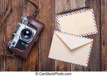 Vintage envelope with post card and retro camera