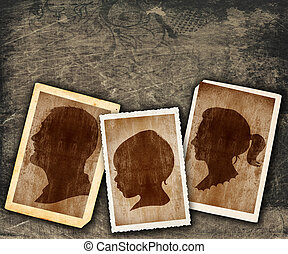 family portraits in vintage silhouette design in old picture frames on grunge wall with copy space