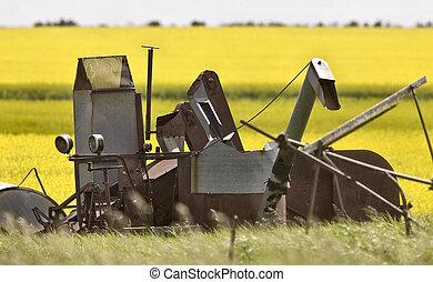 Vintage Farm Equipment against Canalo Background Canada