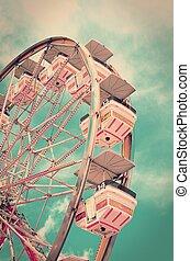 Vintage ferris wheel with old film look.