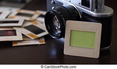 Vintage film camera and slide film with green screen