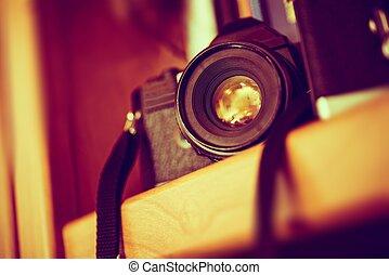 Vintage Film Camera on a Bookshelf. Aged Camera Closeup. ...