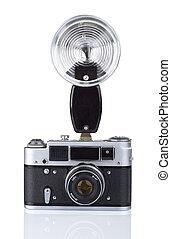 Vintage film camera with flash
