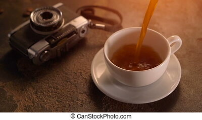 Vintage Film Look: cup of coffee with retro camera