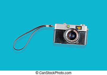 Vintage film photo camera isolated on  background.