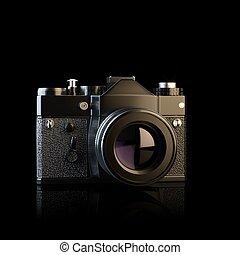 Vintage film photo camera on black