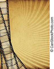 Vintage filmstripes on the sunburst vertical background with space for text.