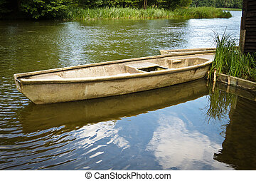Vintage fishing boat in the lake at summer