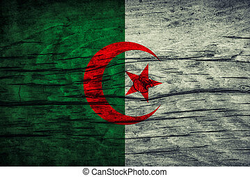 Vintage flag of Algeria on a wooden surface