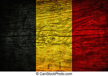 Vintage flag of Belgium on wooden surface