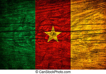 Vintage flag of Cameroon on wooden surface