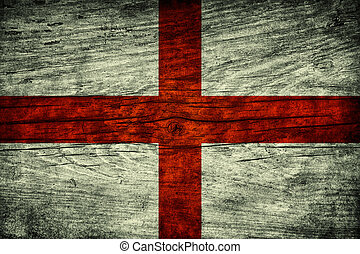 Vintage flag of England on wooden surface
