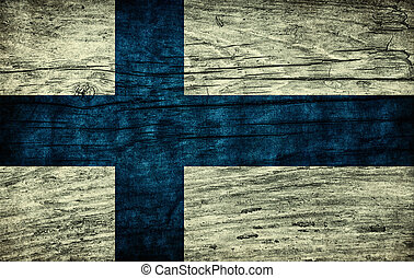 Vintage flag of Finland on wooden surface
