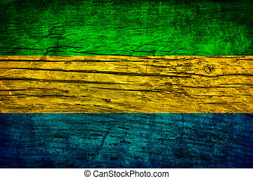 Vintage flag of Gabon on a wooden surface