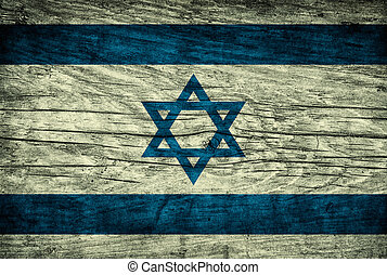 Vintage flag of Israel on wooden surface