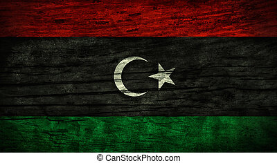 Vintage flag of Libya on wooden surface