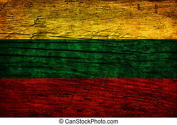 Vintage flag of Lithuania on wooden surface