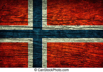 Vintage flag of Norway on wooden surface