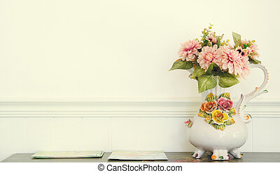 Vintage flower in a pot on a white wall