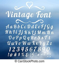 Vintage font lettering on abstract blurry background.