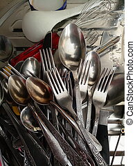 vintage forks and spoons in a pile in the kitchen
