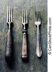 Vintage forks on rustic wooden background