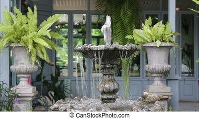 Vintage fountain in coffee shop garden, stock video