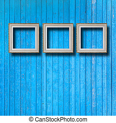 Vintage frame for picture on blue wooden wall
