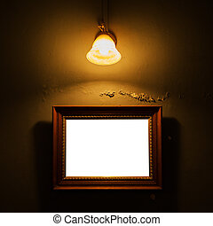 Vintage frame on concrete wall with lamp