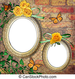 Vintage frames on brick wall with roses, butterfly