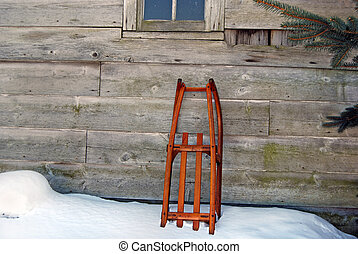 Vintage Fun - Vintage sled leaning on an old barn.