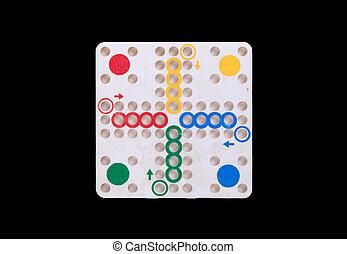 Vintage game of ludo, isolated on black background