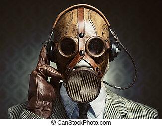 Vintage gas mask and headphones - Man wearing vintage gas...