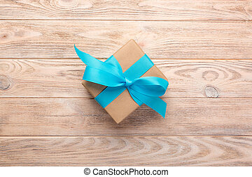 Vintage gift box on wooden background. top view