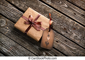 Vintage gift box with tag on background