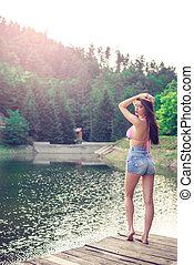 Vintage girl on mountain lake.
