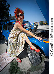 Vintage girl posing in front of the car