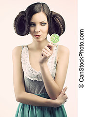 vintage girl with lollipop, she looks the lollipop