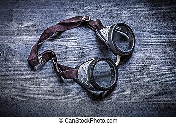 vintage goggles on wood board