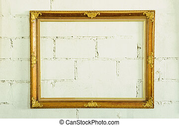 Vintage gold picture frame on white wall