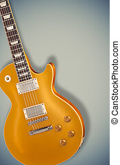 Vintage Gold top guitar over blue soft background